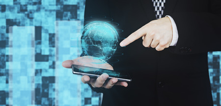 Businessman in Black Suit Holding Smartphone in Hand While Projecting Digital Globe Hud Interface And Pointing Index Finger Towards The Globe Against Futuristic Background 3D Rendering