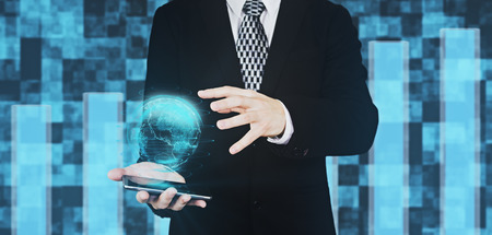 Businessman in Black Suit Holding Smartphone in Hand While Projecting Digital Globe Hud Interface And Hovering His Hand Over The Globe Against Futuristic Background 3D Rendering