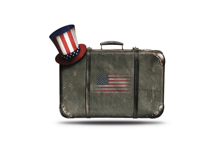 Travel Vintage Leather Suitcase With Uncle Sam's Hat and American Flag. Happy 4th of July Independence Day United States Of America