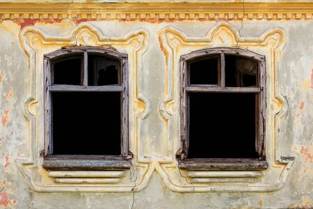 Windows With Vintage Decor On a Ornate, Rustic, Worn, Aged Wall