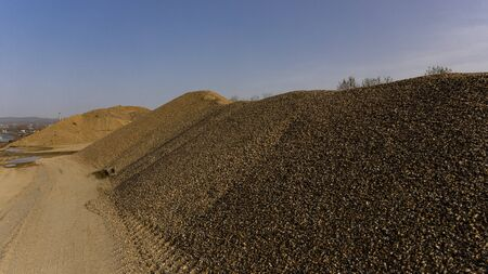 Gravel pile at the quarry. Industrial and construction concept