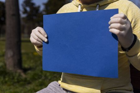 Blue chroma key paper held by a man in surgical gloves