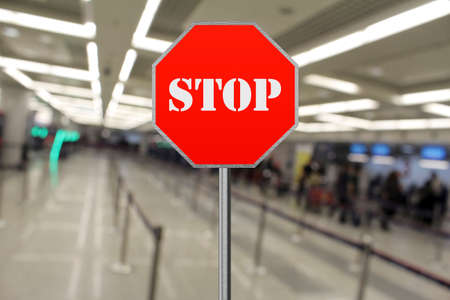 Stop sign at the closed airport due to Coronavirus, Covid19 免版税图像