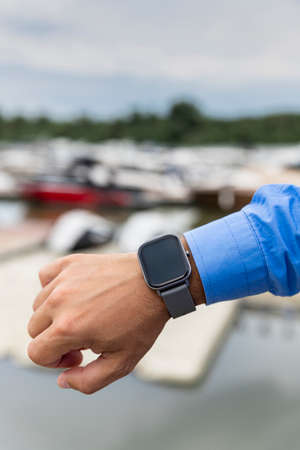 Smart watch on the man's hand. Technology and electronics