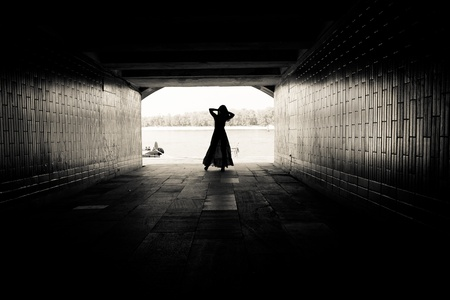 Silhouette of a girl on bright background at the end of an underground pedestrian tunnel Stock Photo - 18530334