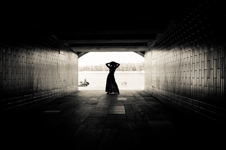Silhouette of a girl on bright background at the end of an underground pedestrian tunnel Stock Photo - 18530335