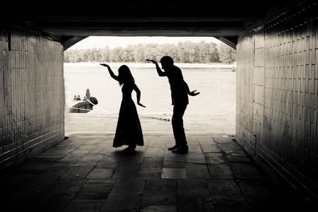 Silhouette of a couple on bright background at the end of an underground pedestrian tunnel Stock Photo - 18530302