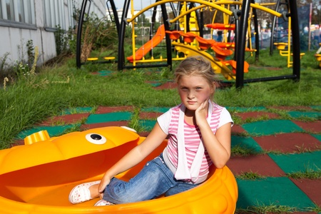 Pre-teenage girl on a playground photo