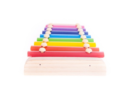 Colorful child wooden xylophone isolated on white photo