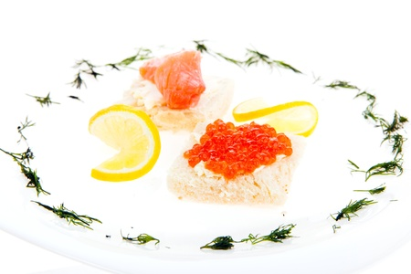 Food composition of sandwiches with butter, salmon and red caviar Stock Photo - 18530277