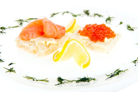 Food composition of sandwiches with butter, salmon and red caviar Stock Photo - 18530308