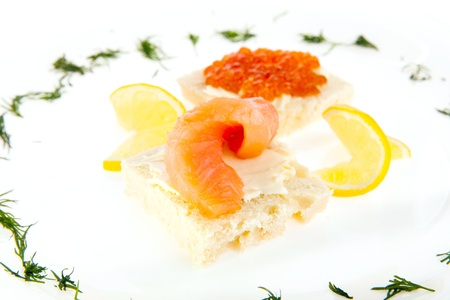 Food composition of sandwiches with butter, salmon and red caviar Stock Photo - 18530291