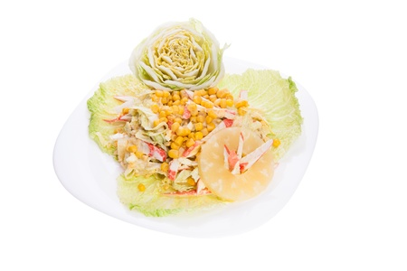 Pretty mixed chef salad with white dressing decorated with pineapple and cabbage photo