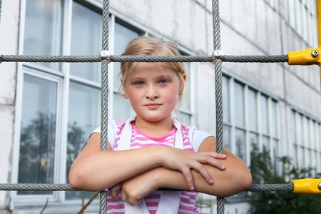 Young girl model on children playground photo