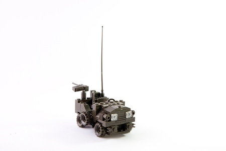 Toy military jeep made of connects with toy machine gun and antenna photo
