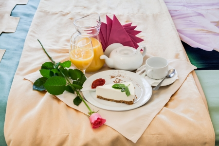 Romantic breakfast with orange juice and flower rose photo