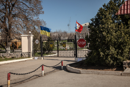 overtaken: BELBEK, UKRAINE - March 21, 2014 Entrance gate to the Ukrainian military base A4515 before being overtaken by Russian occupants Editorial