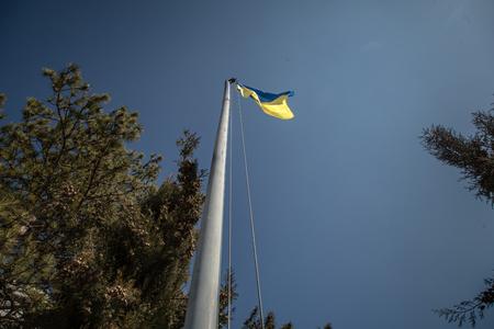 overtaken: BELBEK, UKRAINE - March 21, 2014 Ukrainian flag over military base A4515 before being overtaken by Russian occupants
