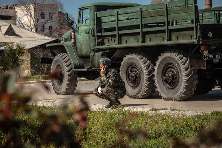 overtaken: BELBEK, UKRAINE - March 21, 2014 Soldiers on the last day of the Ukrainian military base A4515 before being overtaken by Russian occupants