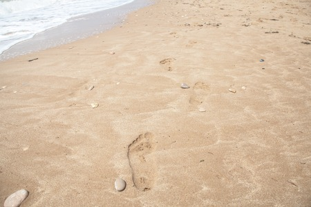 flatfoot: Flat-foot footprints in the sand at seaside