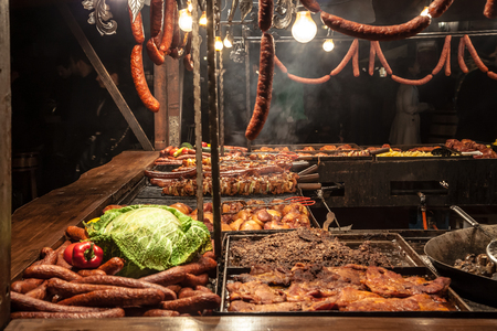 weihnachtsmarkt: Grilled fastfood sausages on mainsquare Krakow Poland
