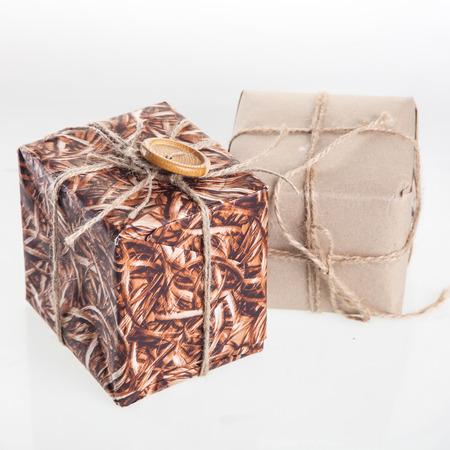 Handmade Christmas gift boxes isolated on white photo
