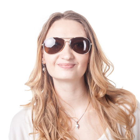 Young woman playing various emotions in sunglasses in studio, emoticons photo