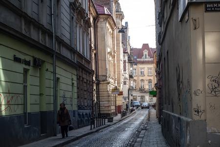 lviv: LVIV, UKRAINE - February 22, 2015: Narrow street of Lviv architecture