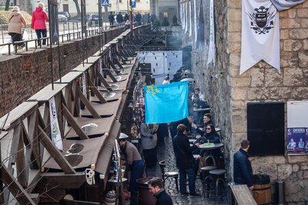 annexation: LVIV, UKRAINE - FEBRUARY 22, 2015: Crimean street food joint under Crimean Tatar flag, opened by Tatar immigrant after take over of Crimea by Russia