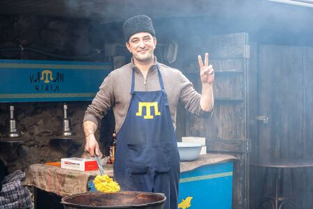 annexation: LVIV, UKRAINE - FEBRUARY 22, 2015: Crimean Tatar national establishing street food business in Lviv after having to flee Russian invasion. One year after annexation of Crimea by Russia