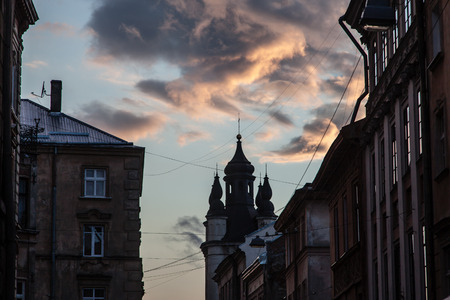 old town guildhall: Church tower silhouette at sunset Lviv Ukraine