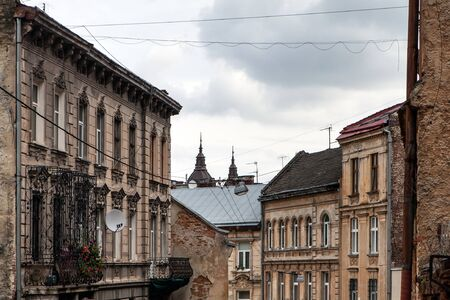 village man: narrow streets of the old European city in fall cityscape