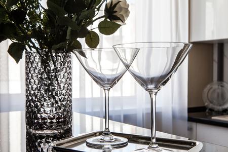 empty martini glasses and flower vase on kitchen counter Reklamní fotografie
