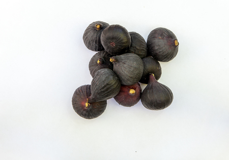 Fresh ripe sweet figs isolated white background. Copy space. Top view, high resolution Standard-Bild
