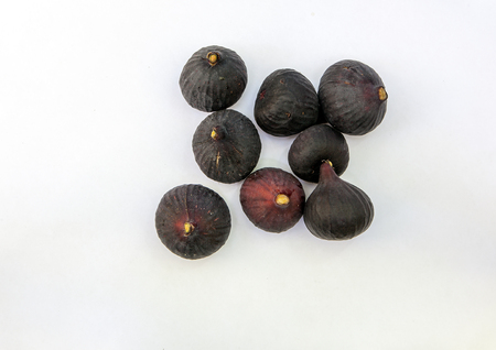 Fresh ripe sweet figs isolated white background. Copy space. Top view, high resolution Foto de archivo