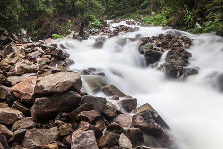 Fast and rapid mountain stream torrent after rain Reklamní fotografie