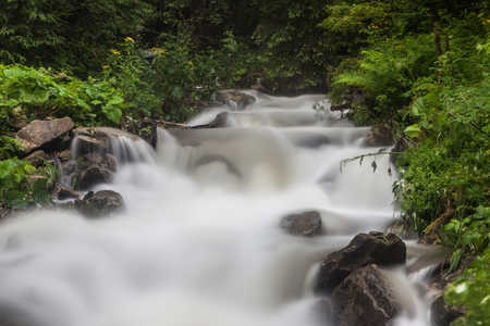 Fast and rapid mountain stream torrent after rain Foto de archivo