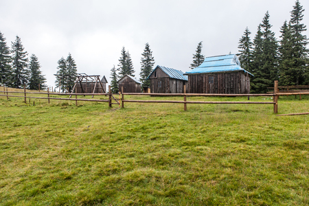 Shepherd wooden hut high in mountain on meadow in autumn season