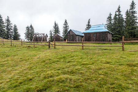 Shepherd wooden hut high in mountain on meadow in autumn season Standard-Bild - 108148746