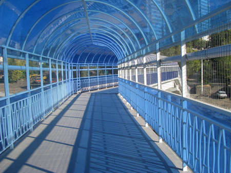 Pedestrian air passage, beautiful, unusual, light arched construction in blue