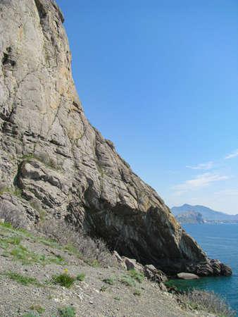 Crimean coast, the steep slope of the Kara-Dag mountain range merges into the sea depths Zdjęcie Seryjne
