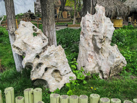 Natural, Decorative, Stones Made of Volcanic Tuff, Are Located On the Garden Plot. Intricate Relief Formed by Wind and Water Reklamní fotografie