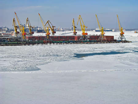 The Black Sea and The Port Are Covered with Ice. Handling Equipment On the Pier Waiting for The Opportunity to Start Work