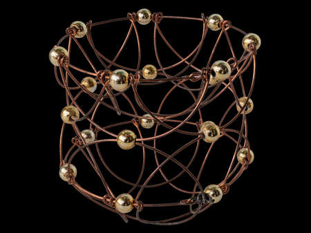 A Puzzle Created by Hand in A Artisanal Way from Wire and Balls. Formed Like a Basket. Isolated On Black Background Banque d'images