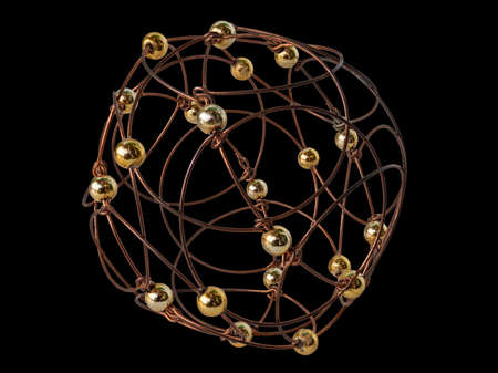 A Puzzle Hand-Made from Wire and Balls. It Is a Stylized Openwork Sphere. Isolated On Black Background Banco de Imagens