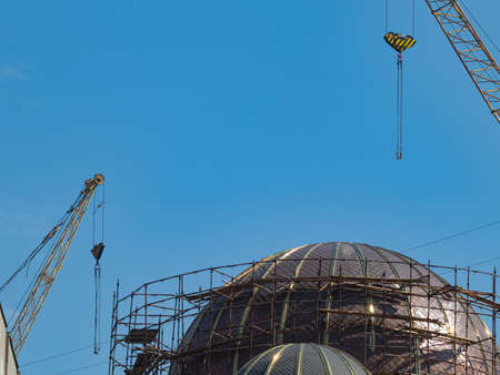 Stage in The Construction and Installation of the Gilded Dome of an Orthodox Church. Working Area Formed by Demountable Scaffolding. Hoisting Cranes Are Ready to Go