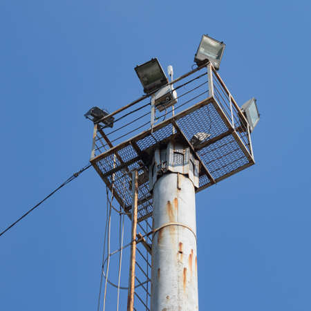 The Observation Floodlight Platform Is Installed On a Pole. The Ladder for Ascent and Descent Is Visible, As Well as The Power Supply and Control Cable Banco de Imagens