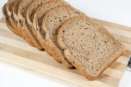 Pieces of grain bread on a board Stock Photo