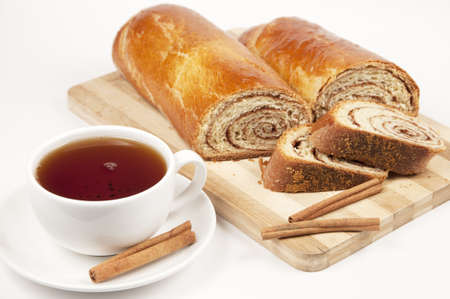 Tea and Home-made dessert - sweet rolls with cinnamon filling