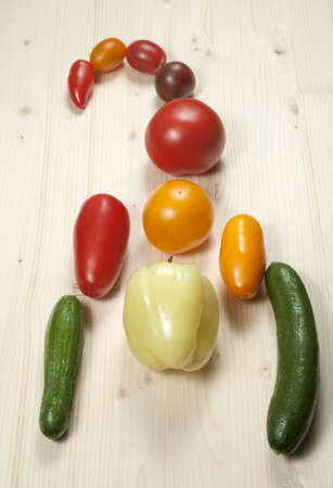 Scorpio from different cultivars of tomatos with paprika and cucumbers photo